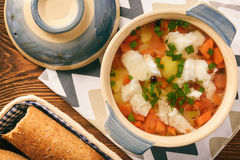 Clear fish soup with vegetables. Stock Image