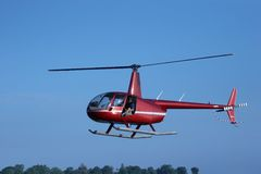 Clear Flying. Small helicopter taking off Stock Photo