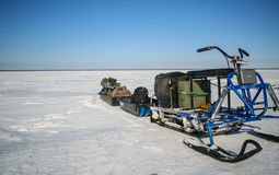 Winter fishing on a snowmobile at the Rybinsk reservoir of the Yaroslavl region Royalty Free Stock Photography