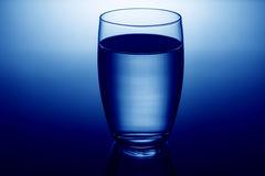 Clear and full glass of water. Background Stock Photo