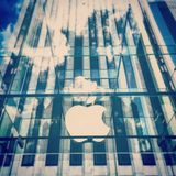 Clear Glass Apple Building Uncer Clouded Blue Sky Stock Images