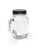 Clear glass bottle with black aluminium cap  on white Royalty Free Stock Images