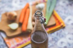 Clear Glass Bottle With Brown Liquid in Selective Focus Photography Royalty Free Stock Photos