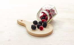 Clear Glass Bottle With Raspberries Inside Royalty Free Stock Photography