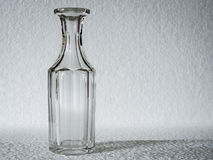 Clear glass bottle. A vintage clear glass bottle with against a white background Royalty Free Stock Images
