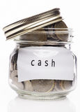 Clear Glass with Cash over white background Stock Image
