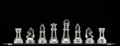 Clear Glass Chess Pieces Stock Image