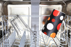 Clear glass and coffee mag in dishwasher Royalty Free Stock Photography