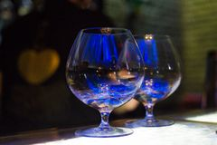 Clear glass for cognac. Two shiny empty clear glass for cognac in restaurant stock images