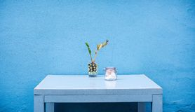 Clear Glass Container on Blue Wooden Table Stock Image