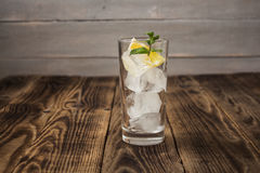 Clear glass with cubes of ice lemon and mint Royalty Free Stock Photography