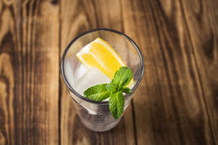 Clear glass with cubes of ice lemon and mint Royalty Free Stock Photo