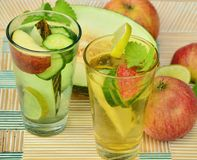 Clear Glass Cup With Fruits and Water Inside Beside Slice Fruitas Royalty Free Stock Images