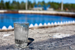 Clear glass filled with purified water. In water treatment plant stock photo