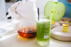 Clear Glass With Green Substance With Fruit Slice Garnish Stock Photos