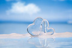 Clear glass hearts in foam Royalty Free Stock Photo