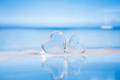 Clear glass hearts in foam Stock Photo