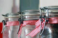 Clear Glass Mason Jar With Red White Ribbon Stock Image