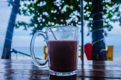 Clear Glass Mug With Beverage on Brown Wooden Table Royalty Free Stock Photos
