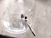 Clear glass mug and saucer Royalty Free Stock Image