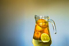Clear Glass Pitcher With Sliced Yellow Round Fruit Inside Stock Photography
