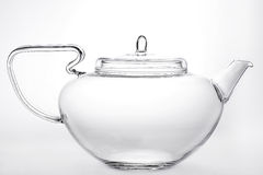 Clear glass teapot. On a gray gradient background Royalty Free Stock Photography
