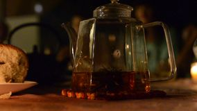 Clear glass teapot with brewing tea stock footage