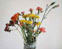 Clear Glass Vase With Red and Yellow Flowers Royalty Free Stock Photography