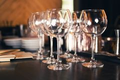 Clear glass for wine. Some shiny empty clear glass for wine in restaurant royalty free stock photos