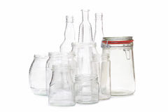 Clear glassware. Clear glass jars and bottles over white background Royalty Free Stock Photography