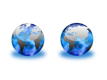 Clear Globes. Two clear globes with sparkling interiors, one showing the eastern hemisphere and the other with a view of the western. Clipping paths are included Stock Image