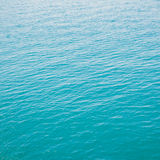 Clear green sea with waves Royalty Free Stock Image