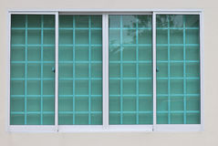 Clear Green Window Glass. A photo taken on some sliding clear green window glass panes Stock Photography