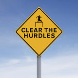 Clear the Hurdles. A road sign indicating Clear the Hurdles Royalty Free Stock Photo