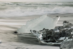 Clear Ice On Beach Royalty Free Stock Photos