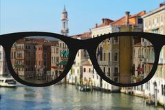Clear image in glasses against blurry landscape Stock Photo