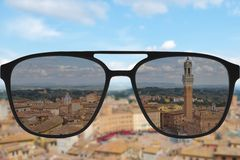 Clear image in sun glasses against blurry land sunny andscape Stock Photos