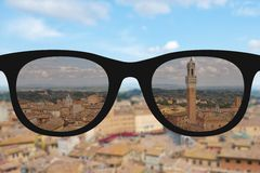 Clear image in woman sun glasses against sunny and blurry landsc Royalty Free Stock Image