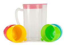 Clear jug with cup Stock Photography