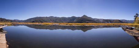 Clear lake surrounded by autumn Stock Photo