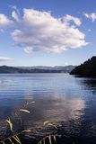 Clear lake surrounded by autumn forest Royalty Free Stock Photo