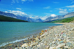 Clear Lake surrounded by mountains in Glacier National Park. Royalty Free Stock Photography