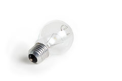 Clear light bulb. Light bulb on clear and blank white surface Royalty Free Stock Images