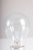 Clear light bulb with filament showing close up Stock Photo