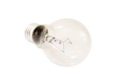 Clear lightbulb on white backround. Closeup of a clear lightbulb on white backround (isolated Royalty Free Stock Photo