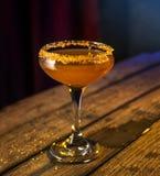 Clear Liquor Glass With Orange Liquid Stock Photography