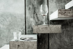 Clear Long Stem Wine Glass and Clear Drinking Glass on Grey Stairs Photo Royalty Free Stock Photo