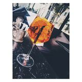 Clear Long-stemmed Glass With Orange Liquid Royalty Free Stock Photography