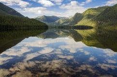 Clear mirror Pozarym lake West Sayan Stock Image