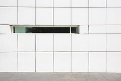 Clear modern facade with a narrow window. Clear modern white facade with a narrow window in Barcelona, Spain Stock Photo